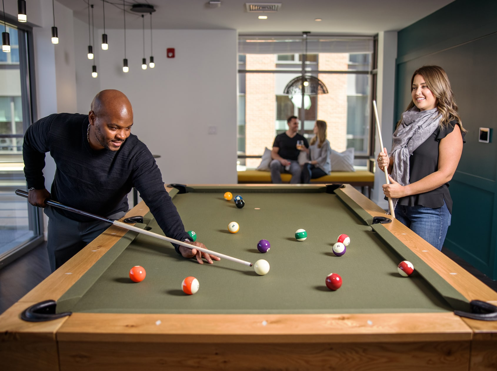 TRIO Apartments - Game room with billiards and shuffleboard